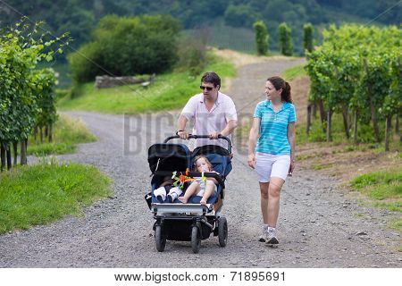 Parents Hiking With Double Stroller