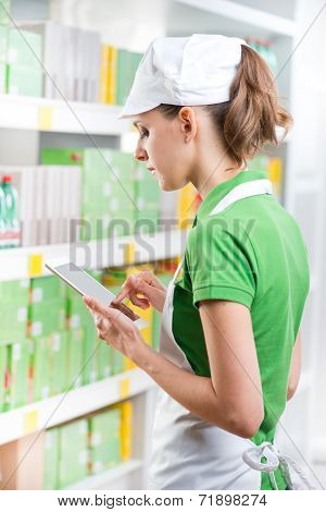 Sales Clerk With Tablet