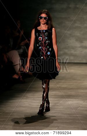 NEW YORK-SEP 8: A model walks the runway at the Libertine fashion show during Mercedes-Benz Fashion Week Spring/Summer 2015 at The Pavillion at Lincoln Center on September 8, 2014 in New York City.