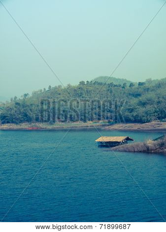 Floating Bamboo Hut In.mae Suay Reservoir In Chiang Rai, Thailand: Filtered Image:cross Processed Vi