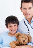 Portrait Of A Cute Little Boy And His Doctor