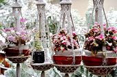 foto of planters  - Winter snow on patio deck with hanging planters outdoors.
