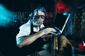image of time machine  - Old scientist working in his laboratory - JPG