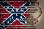image of confederate flag  - Dark brick wall texture with plaster  - JPG