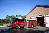 stock photo of fire-station  - Red and black fire engine parked in front of Fire Station number 3 - JPG