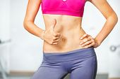 picture of six pack  - Closeup of young slim woman with six - JPG