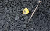 pic of power-shovel  - Shovel mining helmet in the background heap of coal - JPG