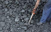 foto of power-shovel  - Miner working at shoveling coal stone mine - JPG