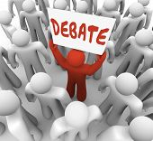 stock photo of debate  - Debate word written on a sign held by a man or person who wants to share his view in an argument - JPG