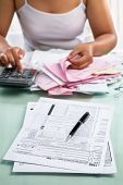 Tax From And Woman Calculating Bills