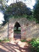 stock photo of backwoods  - Forest pathway gateway arch photographed at Brixham in Devon - JPG