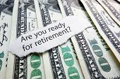 picture of retirement  - Retirement readiness newspaper headline on hundred dollar bills - JPG