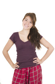 picture of pyjama  - Beautiful young girl student teenager wearing purple pyjamas smiling with hand on hips isolated on white - JPG