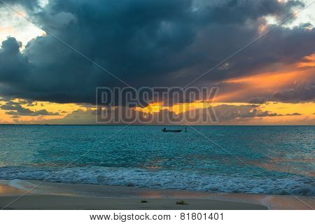 Sailing boat in beautiful sunset