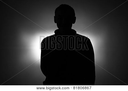 Silhouette of young man in pullover