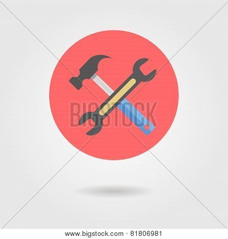 wrench and hammer in circle with shadow