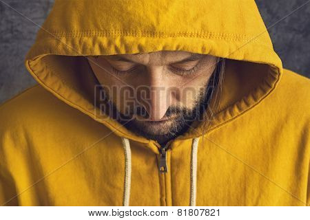 Man Wearing Yellow Hooded Jacket