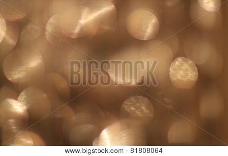 Festive beige background with bokeh effect