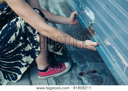 Woman Unlocking Garage Door