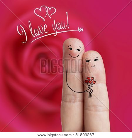 Finger art of a Happy couple. Man is giving bouquet. Stock Image
