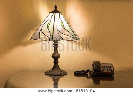 Table Lamp And Phone On Desk
