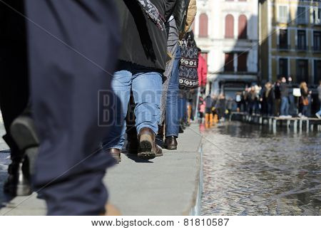 People Walking on the catwalk In Venice Italy