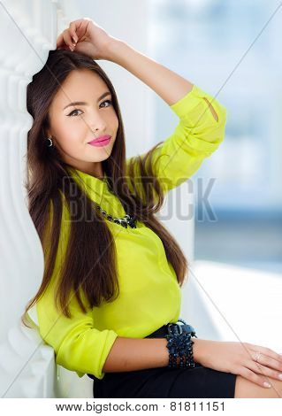 Portrait of a beautiful young Oriental woman in the city.