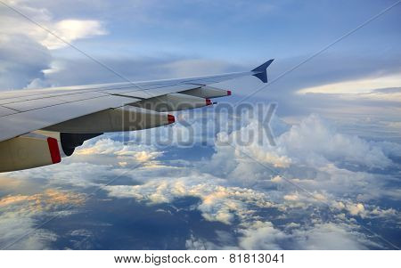 Plane wing over clouds