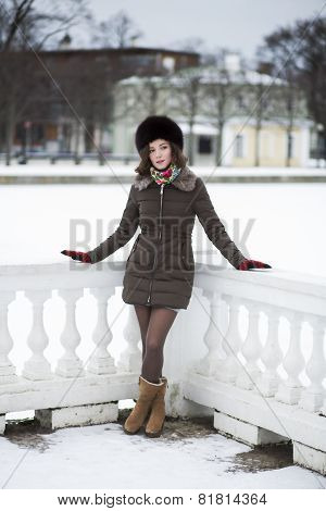 Beautiful Young Woman In A Short Coat