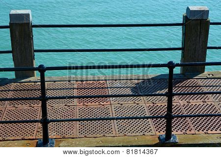 Edge Of Pier With Sea. Worthing. England