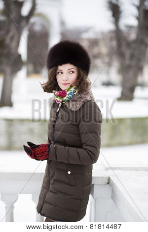 Young Woman With Mittens In The Park