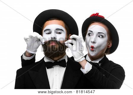 Two memes as businessmen. Woman making a face man adjusting his mustache