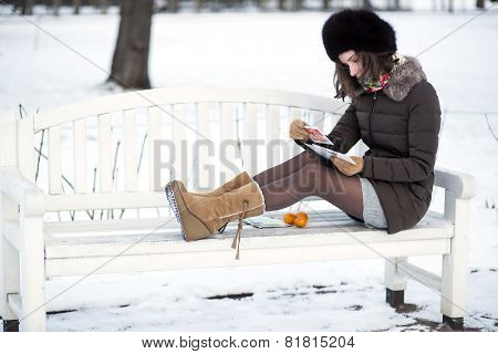 Girl Takes A Look At A Postcard
