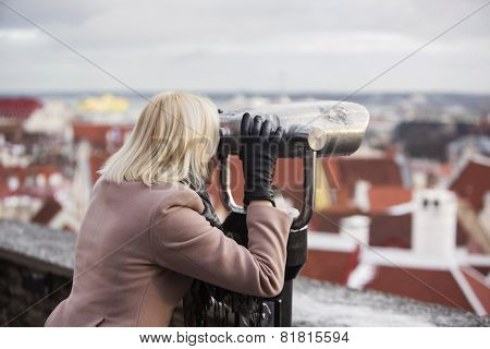 Taking A City View By Binoculars