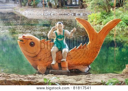asian statue in the lake, Ninh Binh, Vietnam