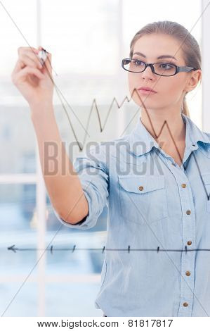 Attractive Businesswoman Drawing A Graph.