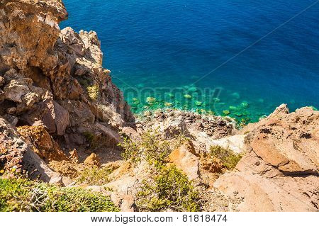 Rocky Beach And Clear Turquoise Sea Water