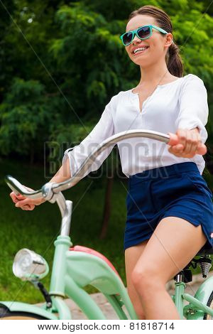 Riding Her New Bike In Park.