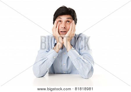 Worried Business Man Sitting At Desk
