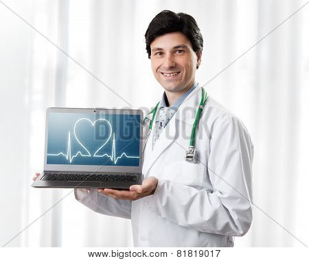 Handsome Doctor Showing Laptop With Heartbeat