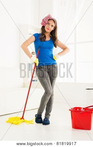Angry Housewife With A Mop