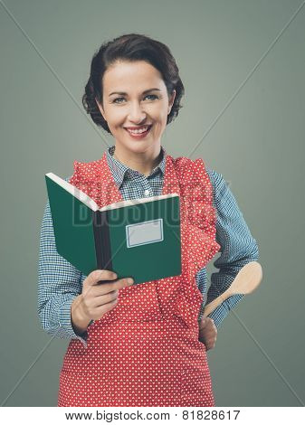 Smiling Woman In Apron With Cookbook