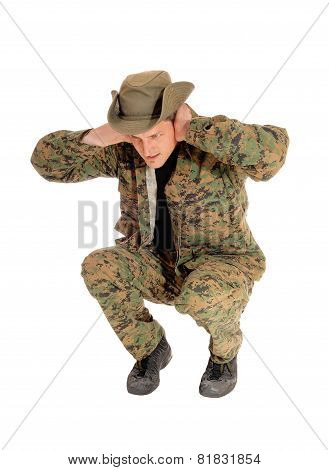 Soldier Crouching On Floor.