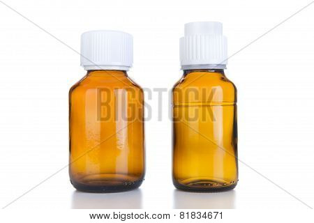 Two Medicine Bottle Of Brown Glass Or Plastic Isolated On White Background, (clipping Work Path Incl
