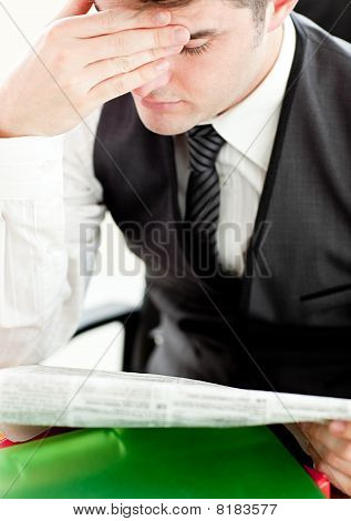 Thinking Businessman Reading A Newspaper