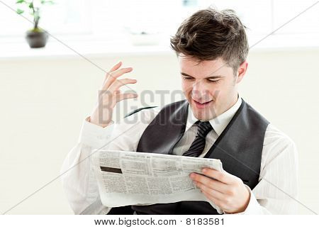 Portrait Of A Positive Businessman Reading A Newspaper