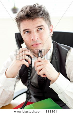 Thoughtful Businessman Talking On Phone