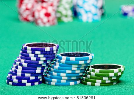 Stack Of Chips On A Green Table