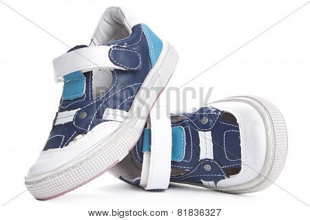 Children's Shoes Isolated Over The White Background