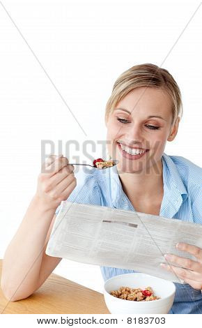 Glowing Woman Eating Cereals While Reading Newspaper